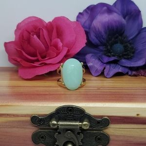 Pale green statement ring